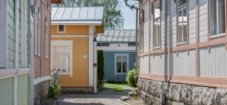 Traditional Old Rauma street view with pastel wooden houses.