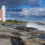 Waves hit the cliffs of Kylmäpihlaja lighthouse island.
