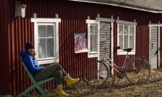 Artist Shannon Amey in the yard of her studio